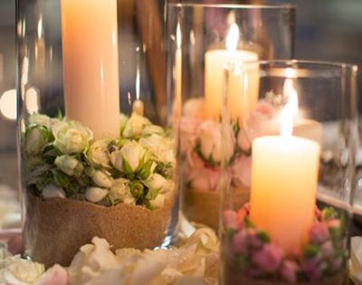 garden wedding - cylinders with candles, rose buds and sand