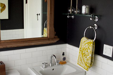 Dark bathroom walls with white tile