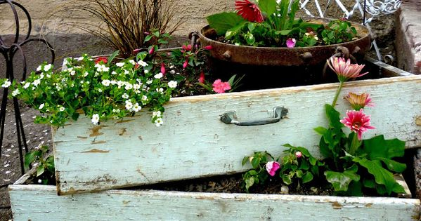 Old dresser drawers used as flower planters from Queen B and Me: