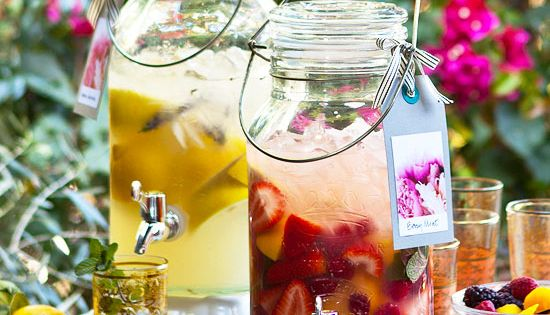 Upgrade your lemonade with fruit! Easy summer decorating. More summer ideas: http://www.midwestliving.com/homes/outdoor-living/31-inspiring-outdoor-table-arrangements/page/14/0