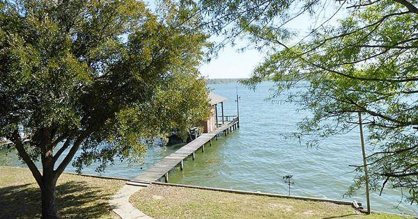 Backyard walk to pier and boathouse lake house style