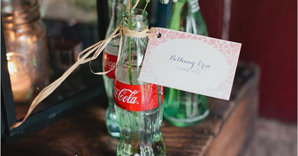 Coke bottles and baby's breath centerpieces. Nice retro red-white combo, if you