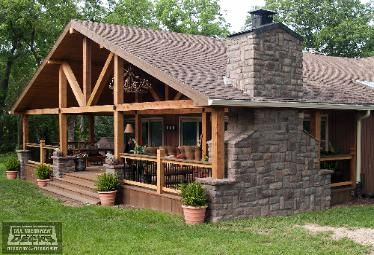 Gable Roof Covered Cedar Deck With Stone Fireplace And Columns And Lighting With Chandelier In Basehor Ks Deck Fireplace Covered Decks Pergola Designs