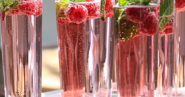 Holiday cocktail - champagne, cranberry juice, raspberries, and mint. [ Borsarifoods.com ]