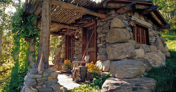 Small lakeside cabin in Montana with sod roof and made from local