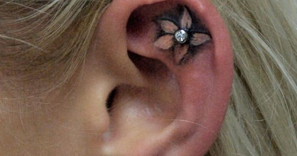 Flower ear tattoo with piercing (cute idea!)