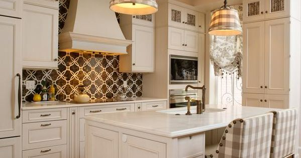 What a GREAT traditional kitchen. The fabric touches in the bar stools,