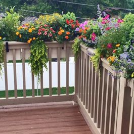 Beige Deck Rail Planters With Hooks On Corner Of Railing Deck