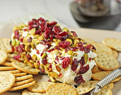 Baked goat cheese with cranberries and pistachios; also yummy spread on pears?