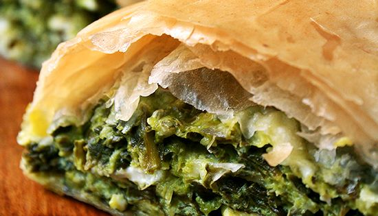 Spanikopita, Phyllo dough wrapped around a filling of spinach, feta, Cottage cheese.