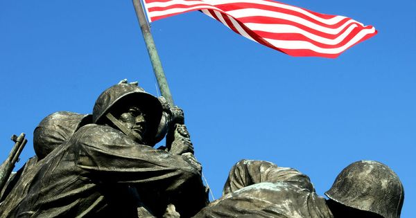 d day men raising flag