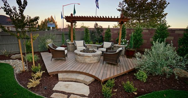 Backyard corner deck with fire pit and landscaping - Love this beyond