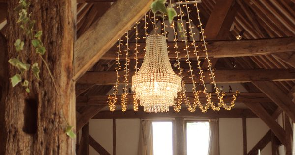 Crystal wedding chandelier with a fairy light canopy at the beautiful Loseley