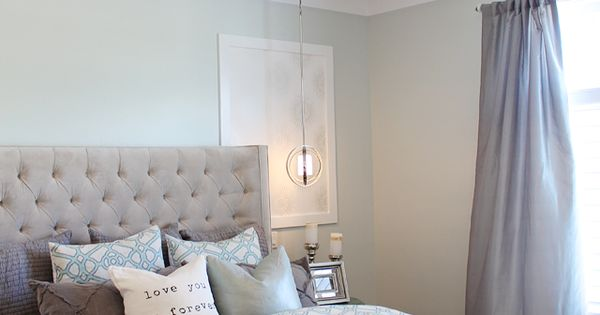 Soothing paint colors of blue and grey for this master bedroom. Thrifty