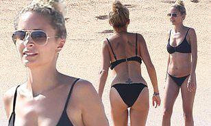 Nicole Richie shows off her toned figure in a black bikini
