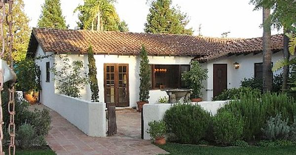 spanish revival meets garden cottage Abel Tan Tan Ramos