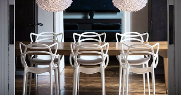 Masters chairs in white by Philippe Starck for Kartell with wooden table