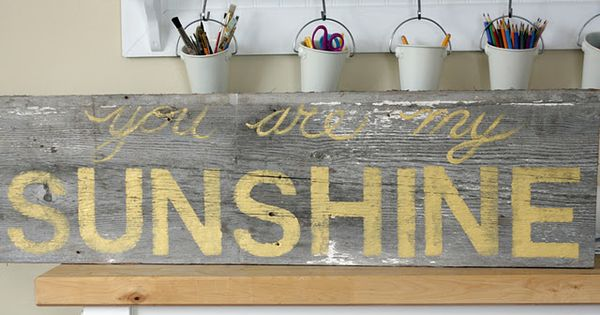 "Stencil ""You are My Sunshine"" on old barn wood."