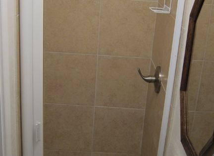 Shower Door With Retractable Storage Built In Squeegee