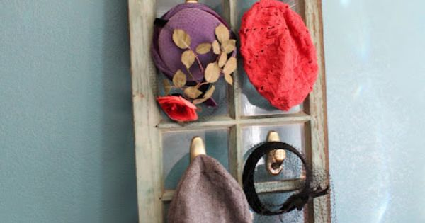 Vintage hat display... could be a fun prop for a Wonderland party.