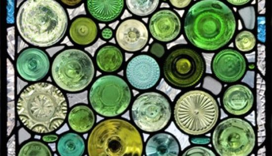 "A ""stained glass"" window made of serving plates, jar lids, etc. love"