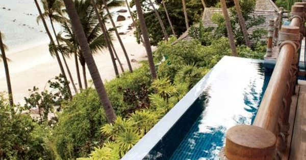Woman relaxes at swimming pool at room No. 909, Four Seasons Resort