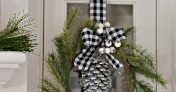 pine wreath with white berries, black and white check ribbon, silver glittered