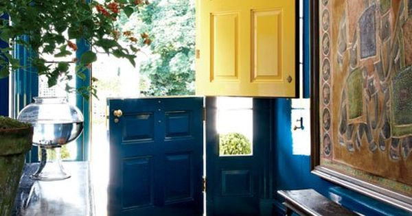 "Dutch Door. ""The oversize Dutch front door [is] painted lemon-yellow . ."
