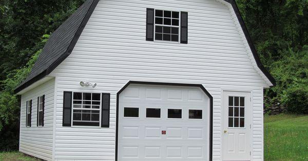 White vinyl siding on a gambrel garage garages for Prefab garage apartment packages