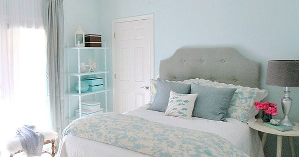 A simple grey, white, and blue room is just what a teenage