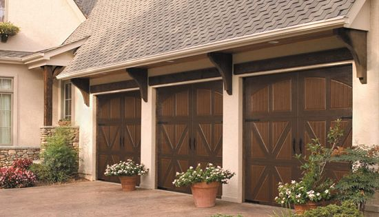 Carriage House Garage Door With Wood Beam Over And Corbels