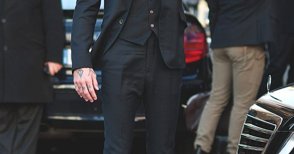 Slim suit, maybe I'll pass on the hand tattoos though.