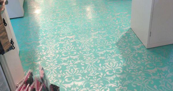 Metallic Paint Stenciled Over Turquoise Floor in