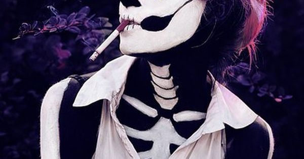Awsome costume! Unusual sugar skull makeup too.