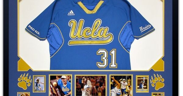 A Framed Ucla Softball Jersey With Bear Paw Cutouts In The