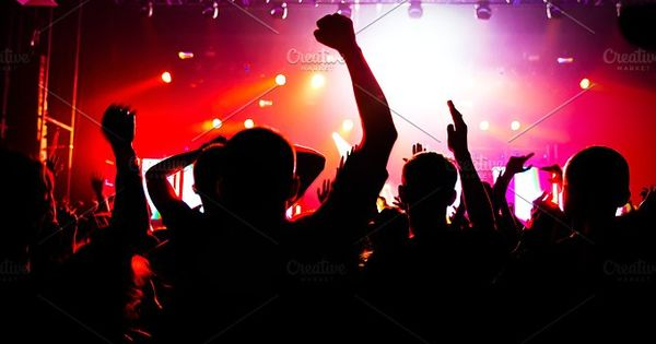 silhouettes of a crowd on a music concert