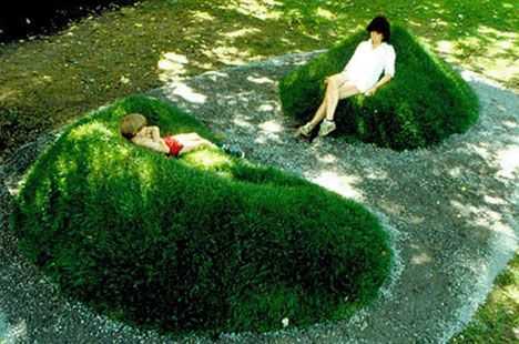Moss/Grass covered garden chairs. By environmental artist Angela Ciotti from a 1983