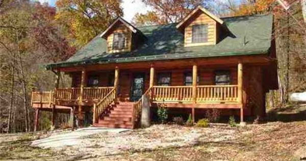 Custom Built Log Home Surrounded By Beautiful Heavily