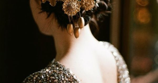 A lovely updo for an Autumn wedding using vintage brooches with an