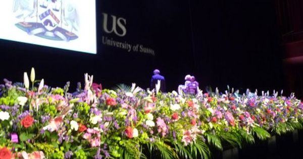 flowers flanking the stage - Google Search | Convocation ...