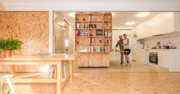 Sliding chipboard units create multifunctional space in - Space madrid ...