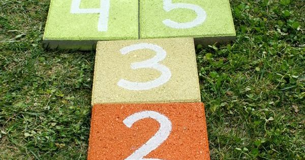 Super easy outdoor rainbow hopscotch - just use garden pavers and spray