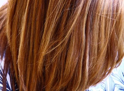 Warm Brown with blonde and honey highlights. -Such a pretty color