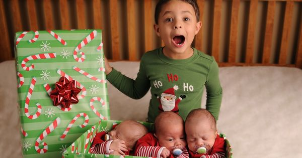 Triplet babies and older sibling Christmas picture