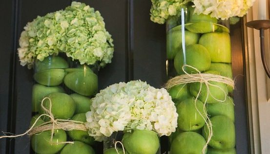 Submerged green apples and dried hydrangeas make a great centrepiece for any
