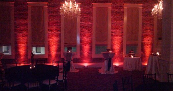 Red Uplighting On Brick Walls Adds An Amazing Ambiance