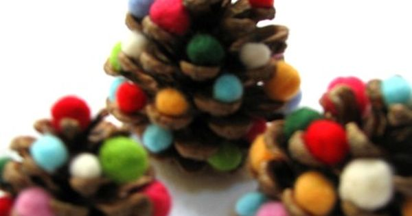 Pinecone Christmas Trees What you need: Pinecones Small pom poms Craft glue