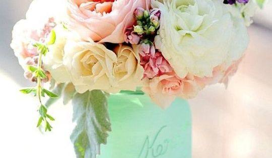 Mint colored Mason jar bouquets on tables