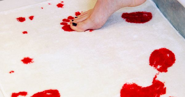 Bath Mat turns red with water. They have matching towels and shower