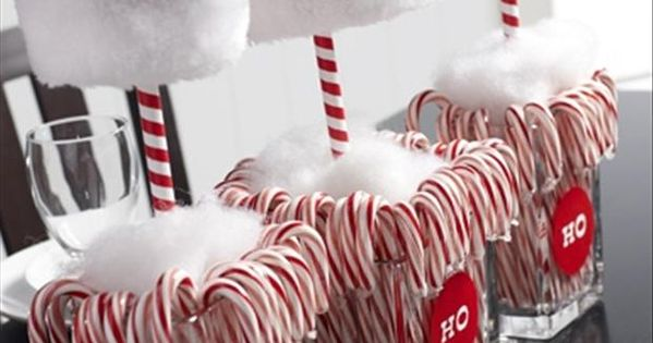 cute christmas centerpiece with candy canes and santa hats